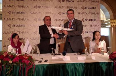 Air Astana's vice-president Ibrahim Zhanlyel (on the right) and second consul of Iran Embassy in Kazakhstan Mahmud Asadi reveal details of flights between Almaty and Tehran