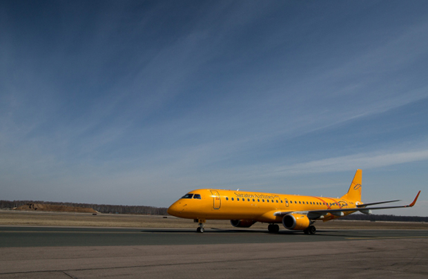 The Embraer-195 AR of Saratov Airlines on the runway of Domodedovo Airport, Moscow