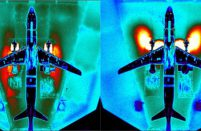 This thermal image shows the flows of air from the MC-21's engines in thrust reversal as the aircraft is braking on the runway